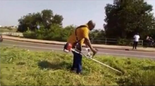 John Mahama clears weed in front of military cemetery